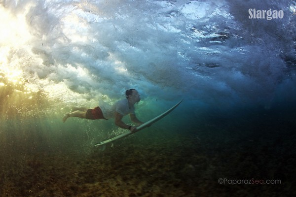 Surfing in Siargao By Jun Lao via Flickr Creative Commons