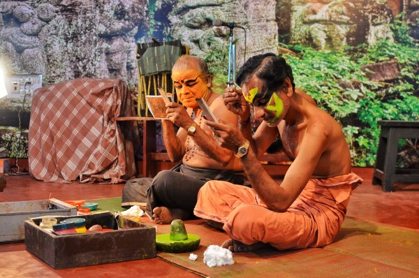 Kathakali Performers putting on their makeup