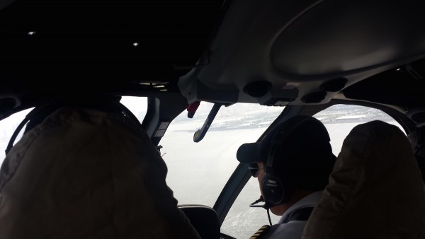 Flying over Manila Bay. Our pilot and co-pilot also serve as our tour guide.