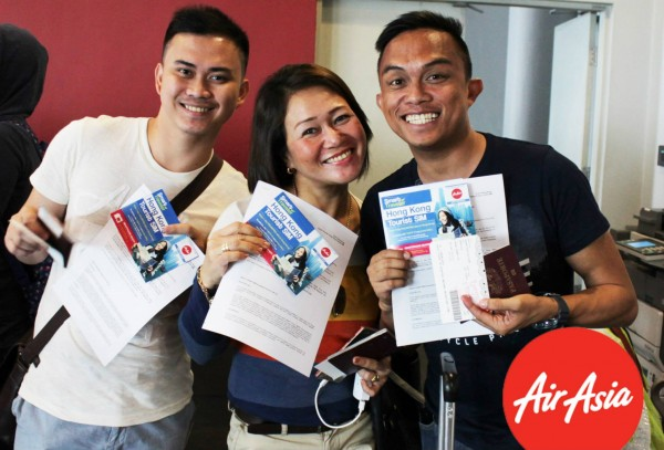 Passengers receiving their FREE PLDT sim cards before boarding