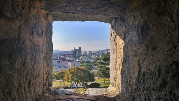 View of the bustling city from the old walls of the Hwaseong Fortress