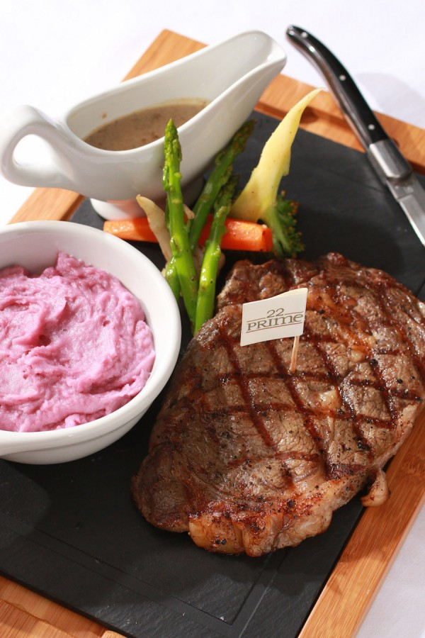 USDA Angus Prime Rib Eye with Purple Potato Purée, Aromatic Vegetables, and Green Peppercorn Sauce