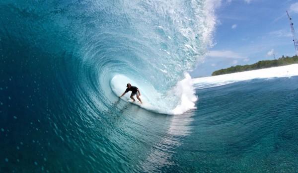 Surfing in Maldives photo by www.theinertia.com