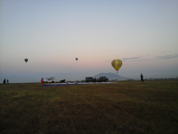 Hot Air Balloons Fly-in at Dusk with the background of Mount Arayat