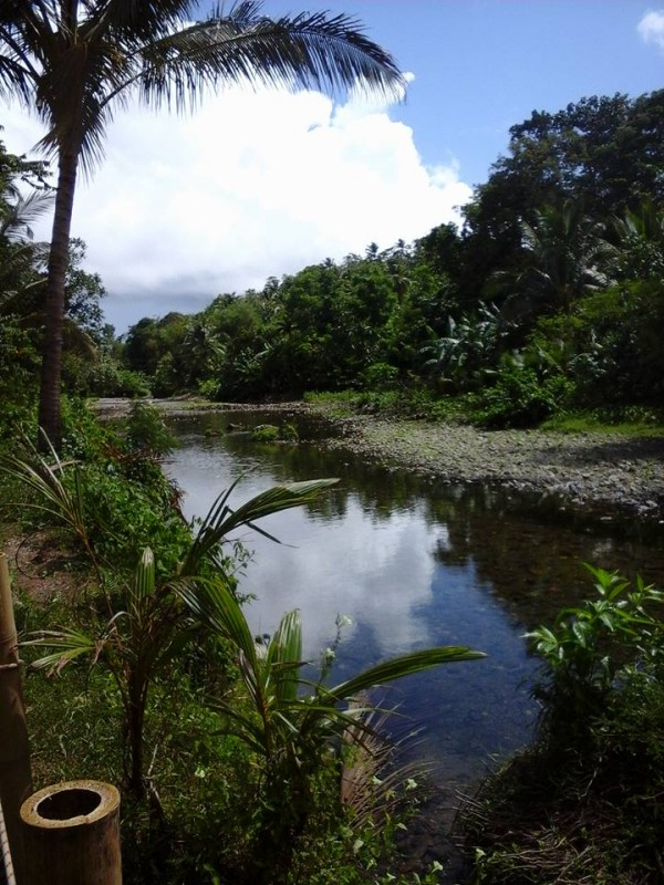 Shallow water running through Nabaoy River during dry season