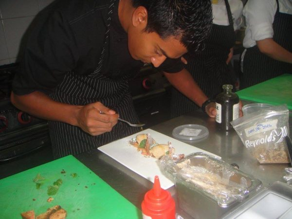The Executive Chef touches up the dessert