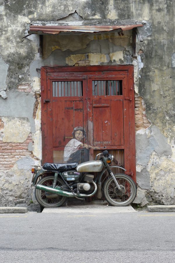 Boy on Motorcycle' street installation from Ernest Zacharevic