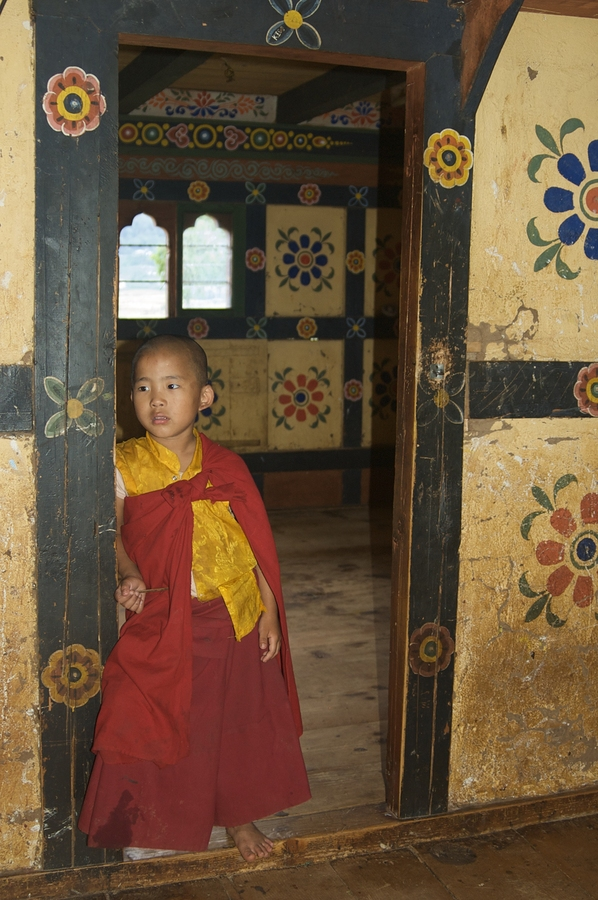 "The little monk is from Chimi Monastery, which stands on a round hillrock. It was built in 1499 by the 14th Drukpa hierarch in Punakha Valley, Bhutan. It is said that Lama Kunley subdued a demon of Dochu La with his ""magic thunderbolt of wisdom"" and trapp"