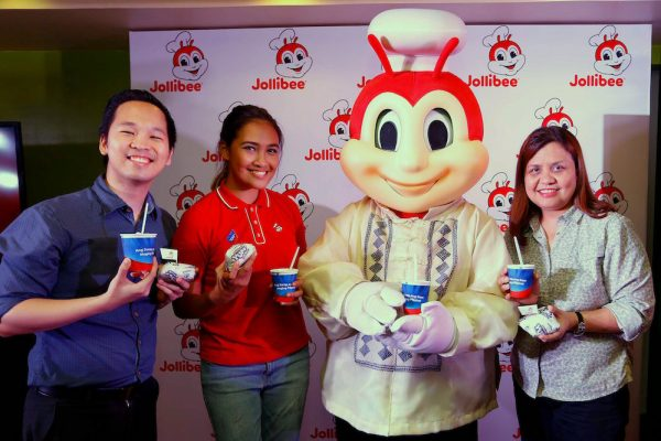 Jollibee brings truly #PinoyAndProud flavors this June! With Jollibee wearing the Barong Tagalog, (from left) Jollibee Brand Manager for Yum! Burger, Mathew Whang, Brand PR and Engagement Manager Cat Trivino, and Brand Communications Director and Head of Kids Marketing Arline Adeva holds up their newest offerings: Adobo Flakes Yum! Burger and Halo-Halo Sundae.
