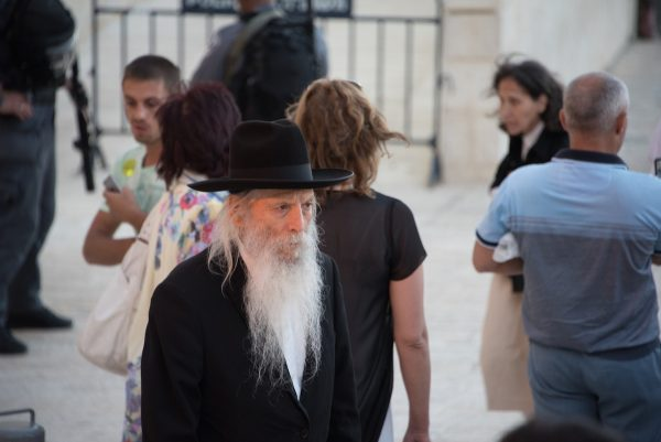 Man returning from church at the Western Wall