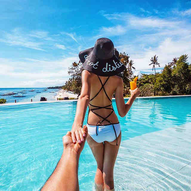 Murad Osmann's hand is stretching out after his wife Natalie Zakharove, who is leading the way to the beautiful infinity pool of Amorita Resort in Panglao Island Bohol