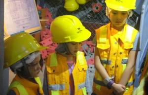 Future innovators listen keenly to instructions at the Construction Site