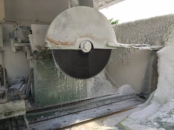 Huge industrial saw to cut slabs of marble at Big J Marble Plant