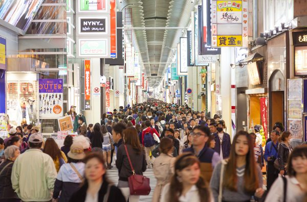 Tourists visiting Shinsaibashi Shopping Street in Dotonbori area of Osaka Japan