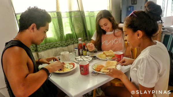 They look disappointed with their breakfast at Le Village Hostel Moalboal