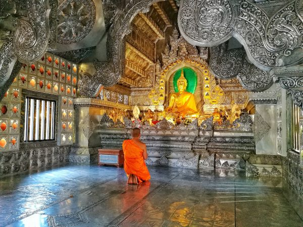 A praying Monk inside Wat Srisuphan
