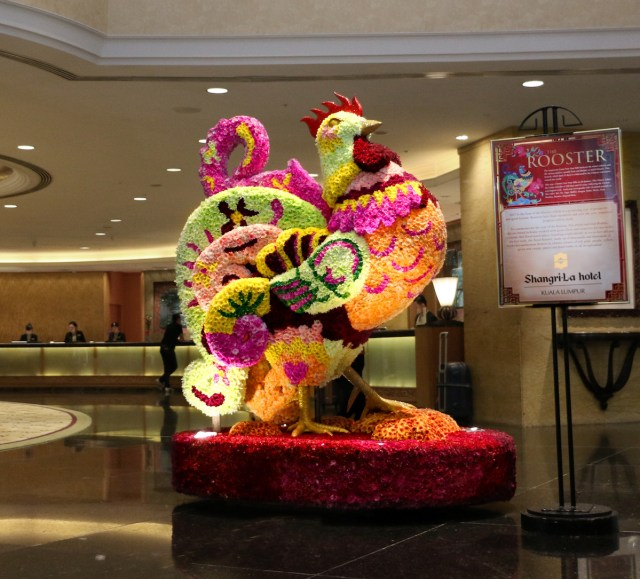 The magnificent floral rooster, made with 20,788 fresh chrysanthemum flowers stands tall at the lobby of Shangri-La Hotel, Kuala Lumpur in all its splendour