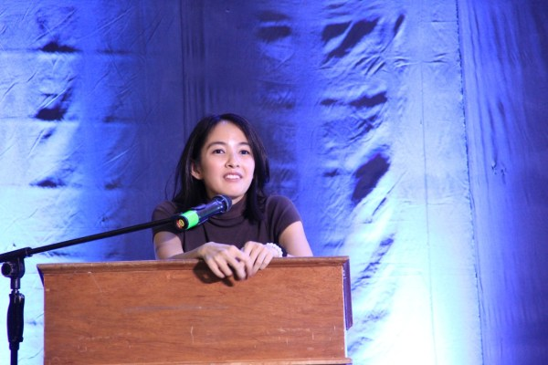 """Sarah Aquino, Director of External Affairs of Juan Portrait, coaxes the young delegates to use travel and tourism as a vehicle for community change in her speech for """"Doing Our Part: Responsible Travelling for the Millennial Traveller."""""""