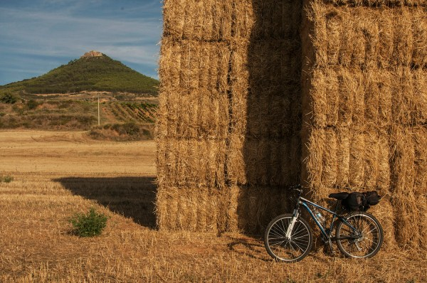 I parked the bike beside this tall haystack to rest and enjoy the view as well as to get some respite from the noise of the traffic on the highway.