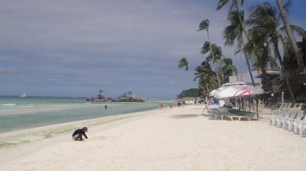 Willy's Rock beyond Boracay Beach Club's beach lounge