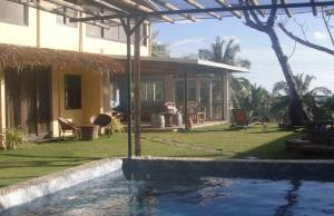 A communal area with a big jacuzzi, comfy arm chairs and a scenic view of Bulabog Beach