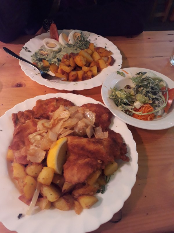 From top: Another of Frankfurt's famous food, Eier in Grune Sosse mit Kartoffeln, salate, and Pork Schnitzel mit Kartoffeln