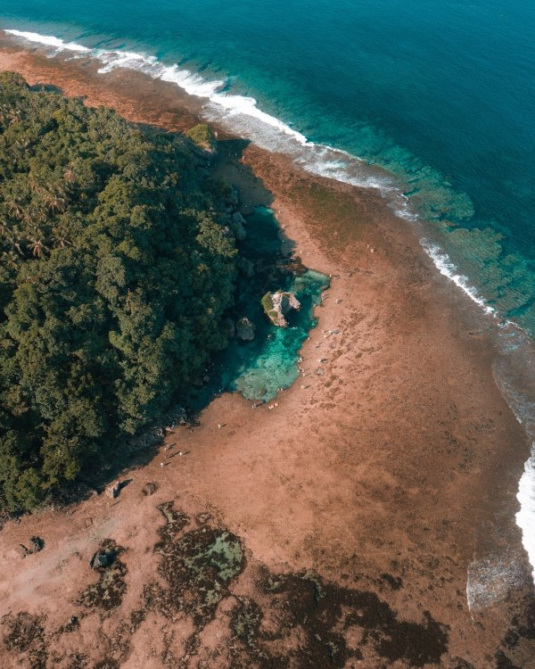 Magpupungko Rock Formation and Tidal Pool by Michael Louie via Unsplash