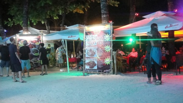 The hitel's nightly beach front scene