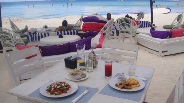 A sunny meal of Watermelon and Feta Salad, Fish Fingers with Fries and Hummus