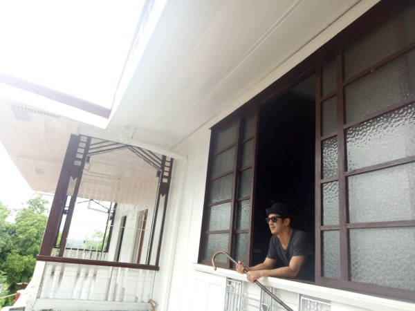 Michael in the window of Apacible ancestral house