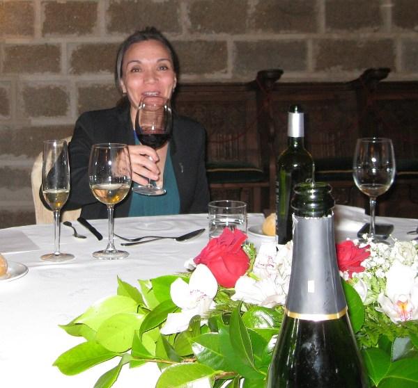 sommelier Catalina Bustillo toasts across the table - Parador de Plasencia