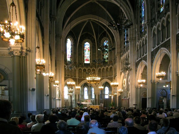 Inside the main basilica, a Mass is held.