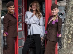 Model Martha Huntwith crew in an iconic British phonebox before walking the runway at celebrated British Julien Macdonald's show at London Fashion Week.