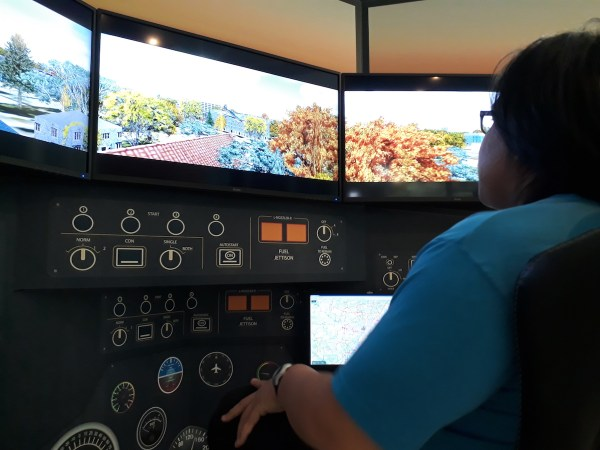 My husband trying out the Lockheed Martin flight simulator, Prepar3D.
