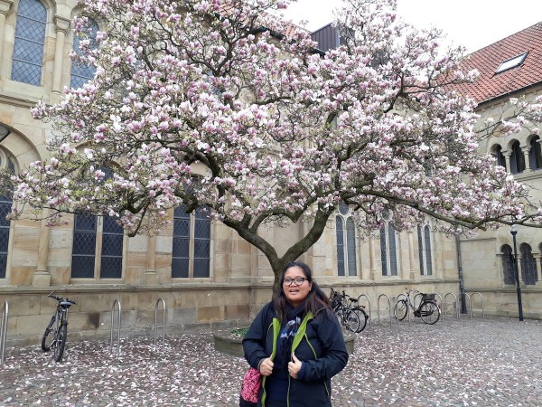 Me standing next to a magnolia tree behind the cathedral in spring