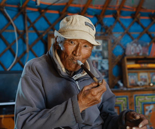 The grandpa of a family who invited us into their house in Mongolia