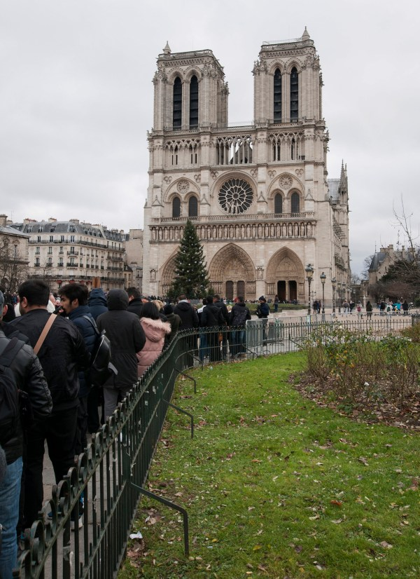 Queueing for security check at the entrance to the esplanade of Notre Dame.