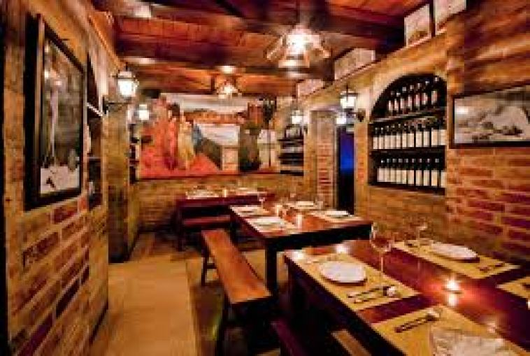 Wall of wines here at Galileo Enotica. Photo via their official website.
