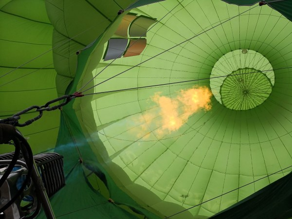 balloon being filled with hot air on the ground before flight