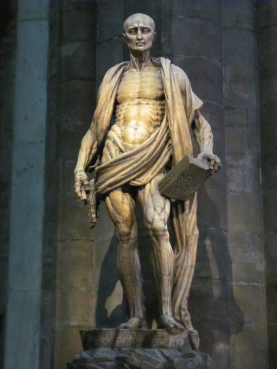 The sculpture of St. Bartholomew by Marco inside Il Duomo