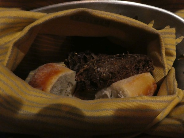 Raisin pumpernickel, rosemary and white bread cuddled in a Frette linen napkin.