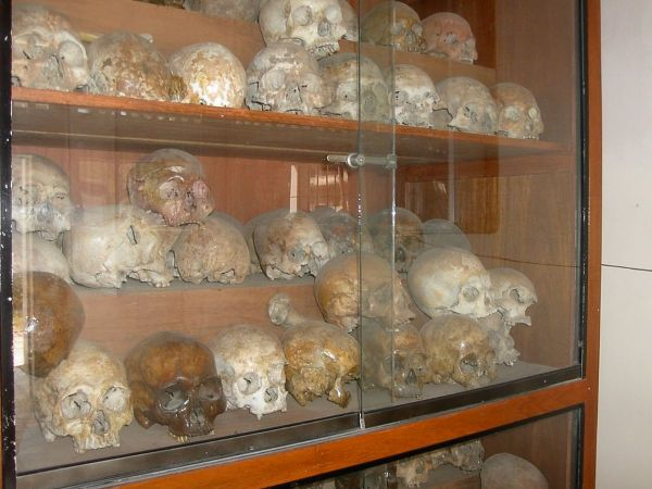 Cabinets filled with human skulls in Tuol Sleng Genocide Museum