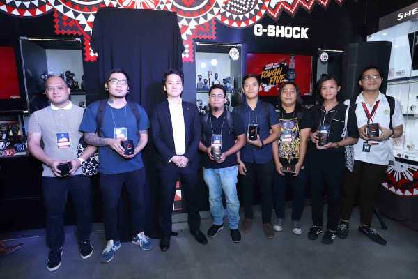 "From L-R: Seven of the ""Design the National G-Shock"" finalists Carlo San Jose, Adrian Delmo, Jerome Banal, Aaron Cedric Manaloto, Dennis Inosanto, Austeen Manalang, and Joshua Panaligan pose for a photo with Casio representative Mr. Masaki Obu."