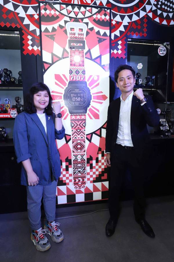 """Design the National G-Shock"" contest winner Dylan Dylanco poses for a photo with International Sales for Timepiece Overseas Marketing and Sales Division Casio Computer Co. LTD sales manager Mr. Masaki Obu, while wearing her winning design."