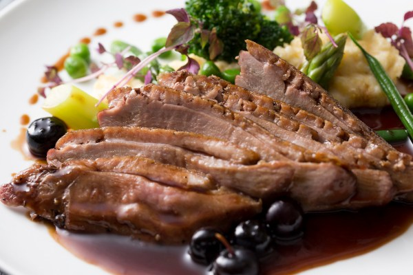 Roasted French Duck Breast served with Pinot Noir Wine Sauce with Herbs
