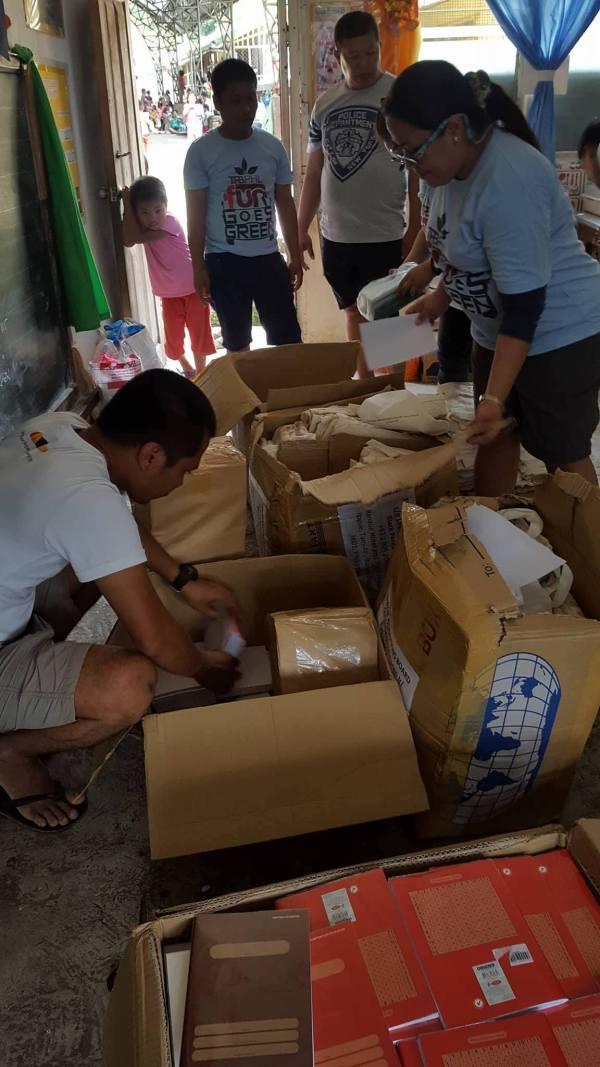 Volunteers packing the school supplies