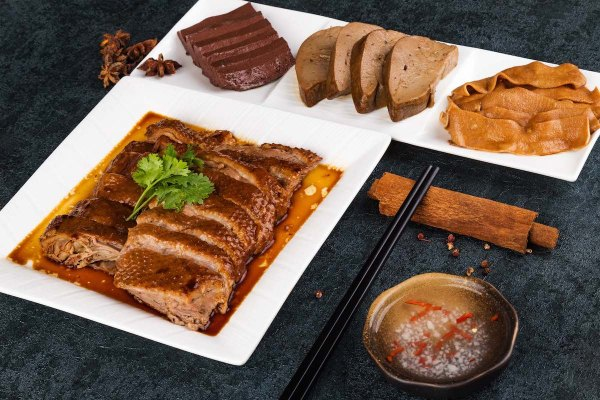 Braised goose from Chenghai is also a signature of the cuisine, showcasing various specialties of the entire bird, including head and neck, webs and wings, liver, gizzard, intestines (from top left to right) and blood (bottom).