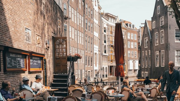 Outdoor Cafe in Amsterdam photo by Ian Valerio via Unsplash