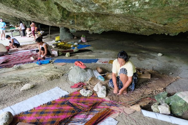 Women weave banigs or mats by hand inside Saob Cave in Brgy. Basiao, Basey, Samar