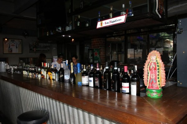 Choose from different house specialties and booze at the bar photo by Prime Lens Studio